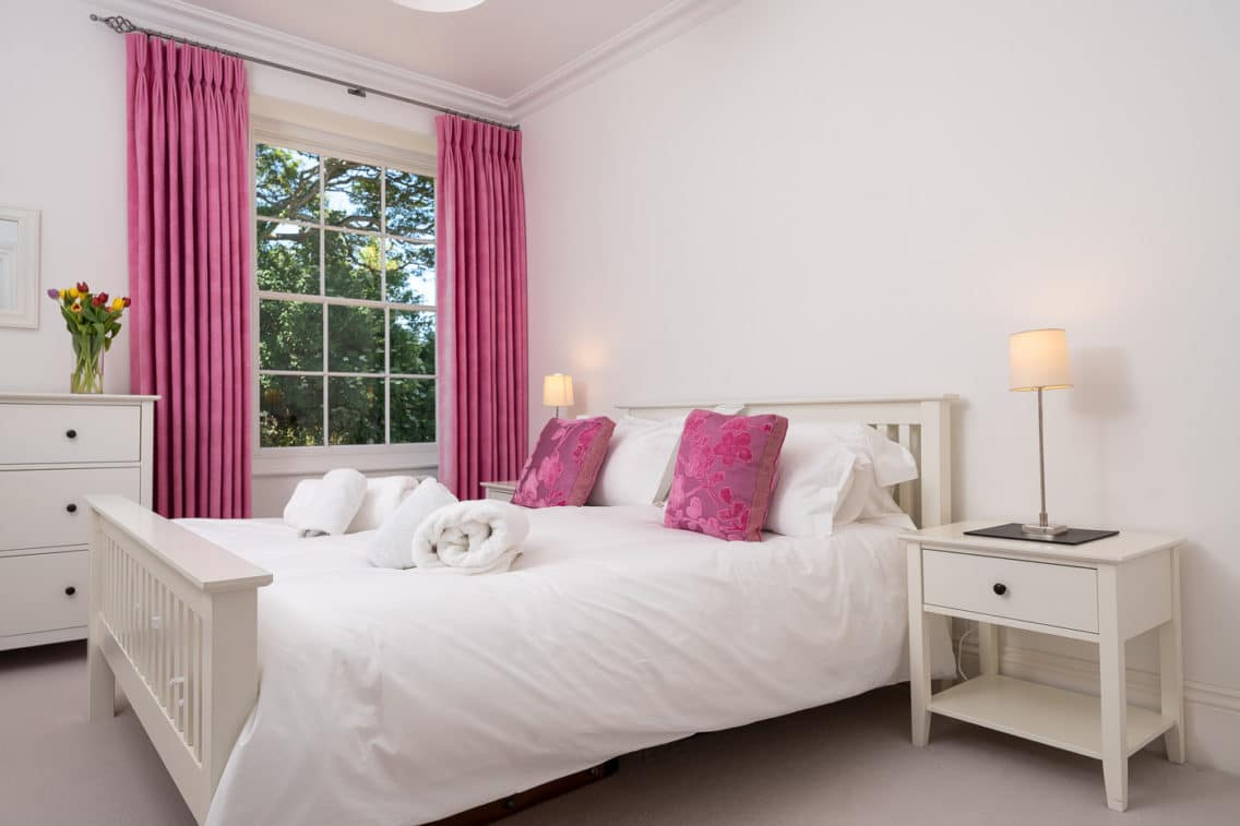 Pink accent bedroom - property photography