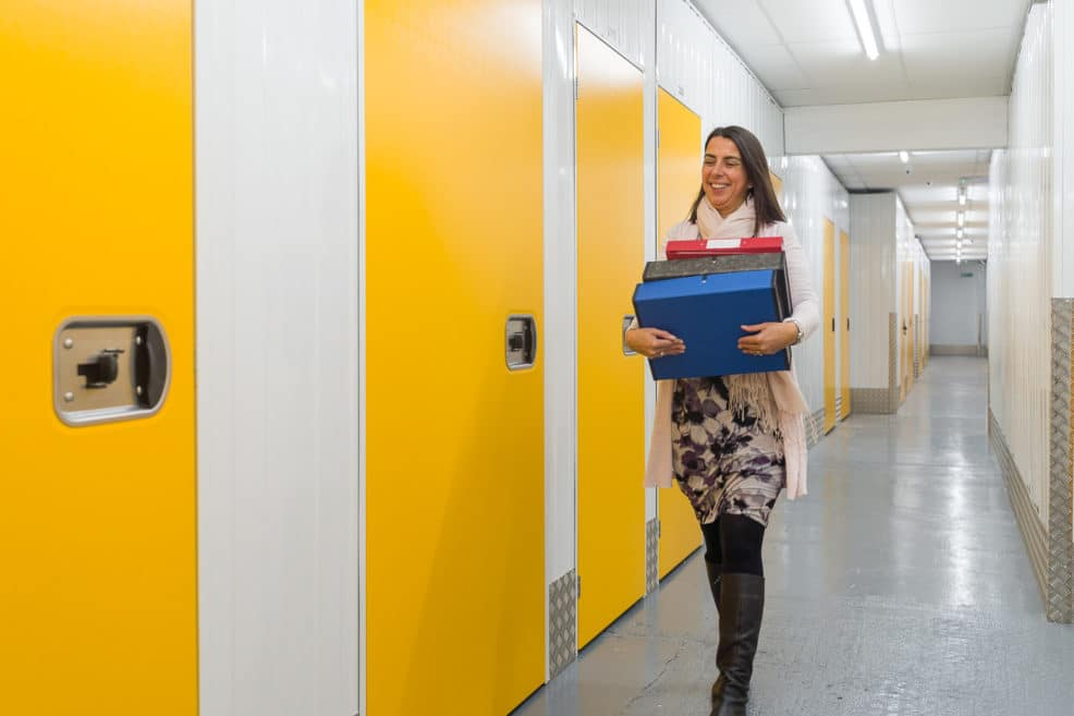 Walking down a corridor carrying files